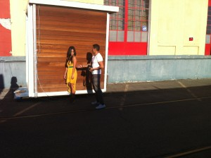 Gusto Lopez and model, outside